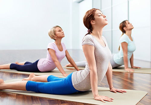 People doing yoga stretches